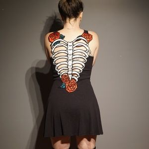 Black dress with skeleton rib cage cut out back